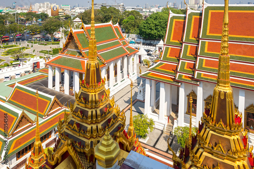 Papiers peints Bangkok The Buddhist temple Wat Ratchanatdaram, meaning Temple of the Royal Niece, situated in the central district of Bangkok. Thai architectural decorative, ornate to see in Wat- and palace roofs and spires