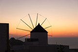 Famous attraction of Oia village at sunset with windmill in Santorini Island. Aegean Sea - 181356343