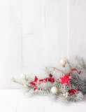 Fir branch with Christmas decorations on white rustic wooden background with copy space for text. - 181364728
