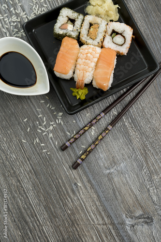 Staande foto Sushi bar Set of sushi and chopsticks, traditional asian dishes.
