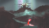 the girl in red hood with magic torch walking on mountain path leading into the fantasy tree, digital art style, illustration painting - 181376762