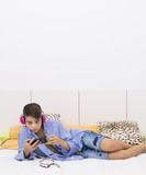 young teenager listening to music in the room - 181385947