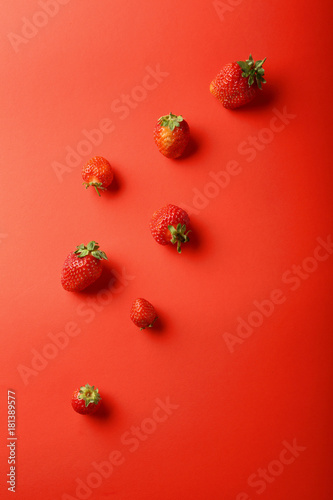 Strawberries on red background - 181389577