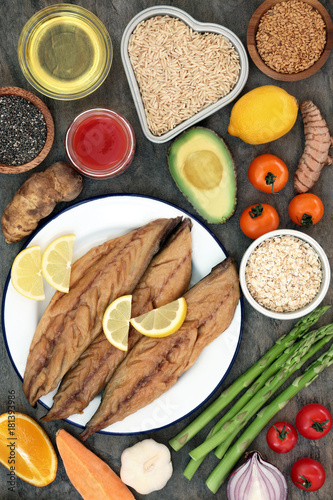 Food to benefit a healthy heart concept with mackerel, vegetables, fruit, tomato juice, spice, seeds, olive oil, cereal and grain. Foods high in antioxidants, vitamins and omega 3 fatty acids. © marilyn barbone