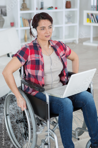 vertical view of disabled woman using laptop