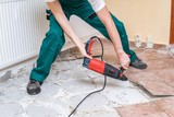 Renovation of old floor. Demolition of old tiles with jackhammer. - 181408573