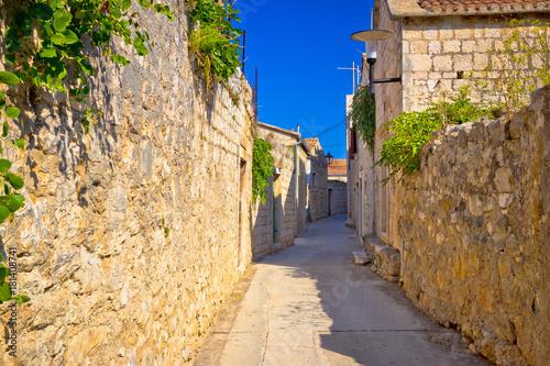 Fototapeta Old narrow stone street of Vis view