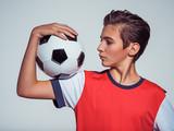 Photo of teen boy in sportswear holding soccer ball - 181445112