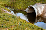 Concrete culvert pipe hole system draining sewage water. Environmental disaster - 181461555
