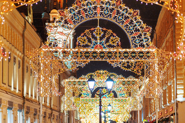 Streets of Moscow decorated for New Year and Christmas celebration. Buildings with light bulbs. Russia.