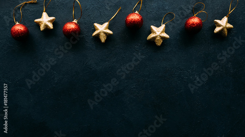 Christmas toys on blue background. Copyspace border concept