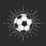 Retro football, soccer logo isolated on a black background with vintage sunburst