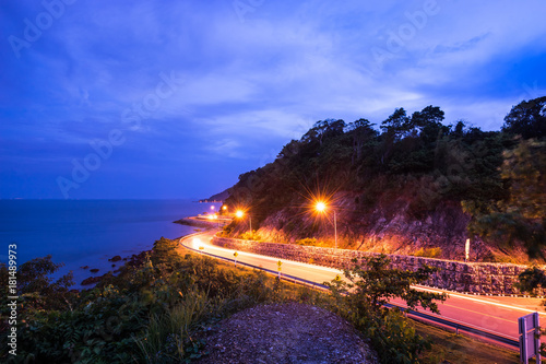 twilight light tail on smooth curve road Poster