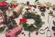 Prepare for xmas. Handmade craft wreath. Making christmas decoration. Tolls, wreath white desk