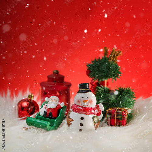 Fotobehang Rood traf. Christmas holiday background with Santa and decorations. Christmas landscape with gifts and snow. Merry christmas and happy new year greeting card with copy-space.