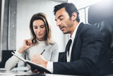 Group of two business person at working process.Young professionals work with new market project. Blurred background.Horizontal.
