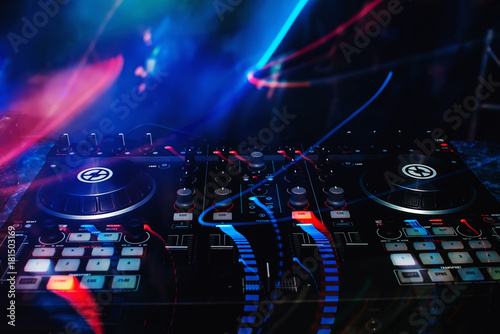 mixer and DJ booth in the nightclub at party c of bright multicolored effects