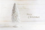 white christmas tree made of flocked wire on  rustic white painted wood with  text  Merry Cristmas, creeting card - 181503312