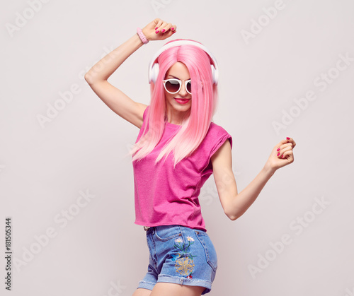 DJ Girl Hipster with Pink Fashion Hairstyle Dance. Young Playful Model Woman in Trendy Headphones Smiling. DJ Music vibrations, Clubbing. Party Style - 181505344
