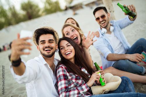 Fotobehang Muziek Happy young group of people taking selfies on beach