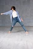 Modern young beautiful dancer in action. Beautiful young hip-hop dancer dancing contemporary urban street dance on studio background. - 181511179