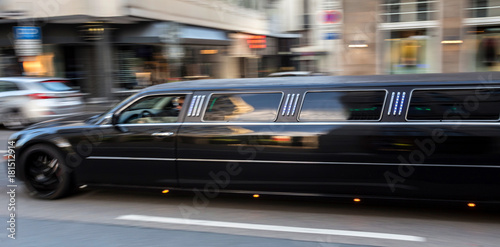 long luxury limousine speeding in the city Poster