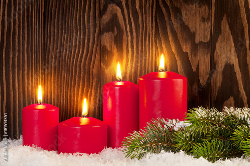Christmas candles and snow fir tree