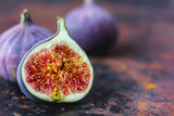 Beautiful and fresh figs on rusty surface. Half of fig. - 181517144