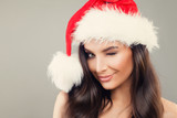 Christmas Woman in Santa Hat Winking. Happy Woman Christmas Concept - 181520166