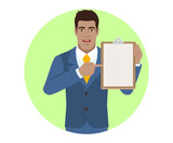 Businessman pointing at a clipboard - 181520310