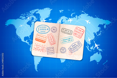 Open foreign passport with international visa stamps on blue world map with airline routes