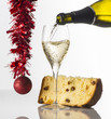 Quadro glass with champagne and Christmas cake on the white background