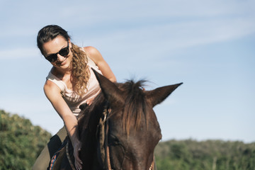 Beautiful woman riding a horse.