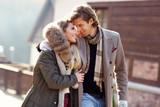 Happy couple walking outdoors in winter - 181538520