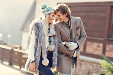 Happy couple walking outdoors in winter