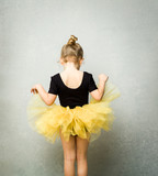Little girl wearing leotard and tulle tutu viewed from behind - 181548957
