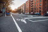 New York City Uptown street with residential building and bicycle road