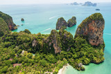 Aerial view of tropical island, white beach, turquoise lagoon, rocks and islands on horizon, Krabi, Railay, Thailand. Life in paradise. Travelling and holiday concept. People resting on the beach. - 181554747