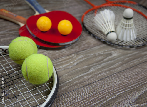 Fotobehang Tennis items for fitness , racquets and accessories for badminton, table tennis and tennis on a wood background
