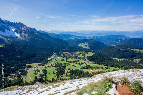Foto op Aluminium Nachtblauw Snow mountains and green valley at summer sunny day. Dolomites Alps, Rosengarden Group, South Tirol, Italy.