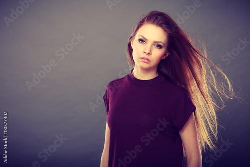 Foto op Canvas Kapsalon Attractive brunette woman with windblown hair