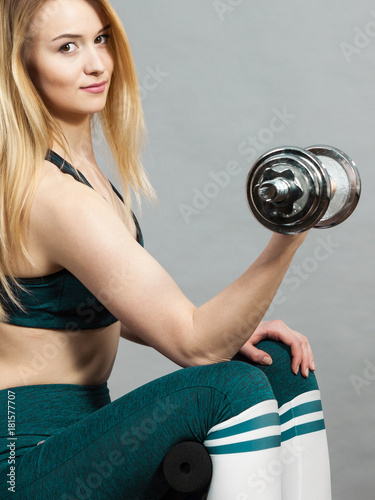 Wall mural Woman training weight lifting