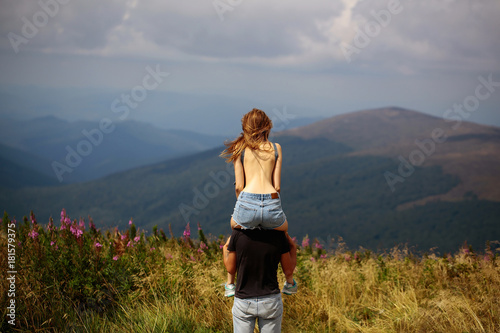 Romantic couple on mountain top Poster