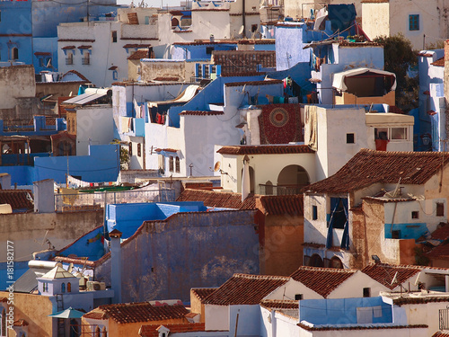 The gorgeous blue alleyways and blue-washed building of Chefchaouen, Morocco - amazing palette of blue and white buildings