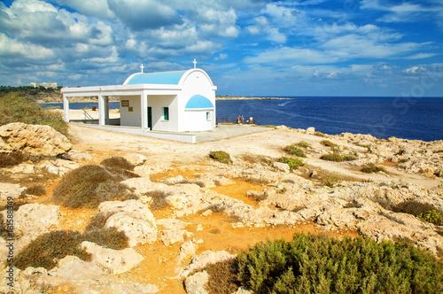 In de dag Cyprus Agioi Anargyroi church at Cape Greco, Protaras,Cyprus. Mediterranean sea coast.
