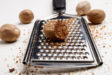 nutmeg and powder on a grater - 181596717