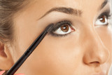 young beautiful woman applied eyeshadow with a brush - 181602503