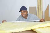 Man measuring insulation - 181602938