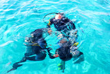 Scuba divers are submerged under water. - 181604526