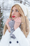 Winter portrait of beautiful blonde young woman in park. - 181612364
